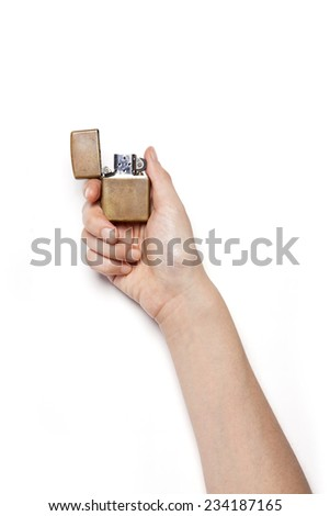 A female hands hold a vintage zippo lighter isolated white, top view at the studio. - stock photo