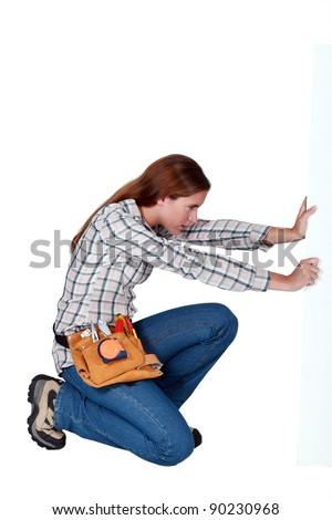 A female handyman. - stock photo