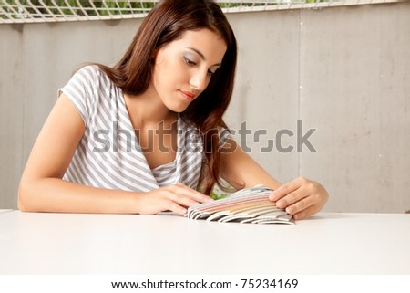 A female interior designer looking at color swatches - stock photo