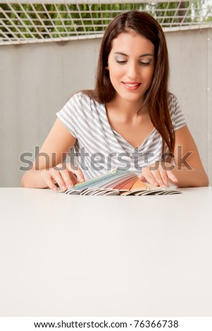 A female interior designer with a group of color swatches - stock photo