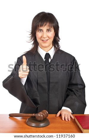 A female judge in a courtroom, success gesture. Shallow depth of field - stock photo