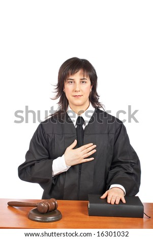 A female judge taking oath in a courtroom, isolated on white background. Shallow depth of field - stock photo