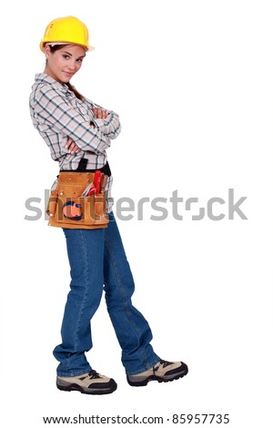 A female manual worker standing with crossed arms. - stock photo