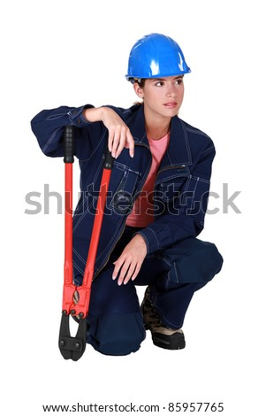A female manual worker with pliers. - stock photo