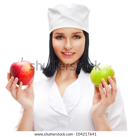 A female medical doctor holding a red and green apples in different arms isolated on white background. Dental care concept