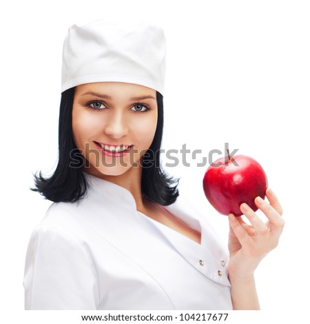 A female medical doctor holding a red apple isolated on white background