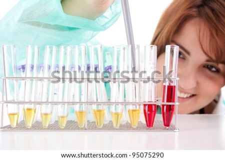 A female medical or scientific researcher or woman doctor working with samples