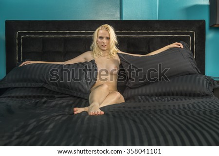 a female model posing in erotic positions - stock photo