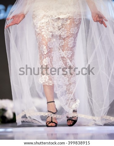 A female model walks the runway with a wedding dress during the 2016 Sofia Fashion Week Show in Sofia, Bulgaria.