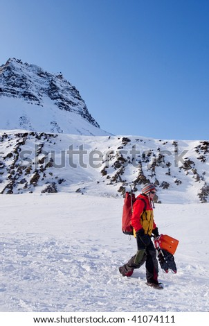 A female mountaineer against a winter mountain landscape - stock photo