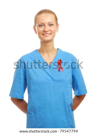 A female nurse with an aids red ribbon pinned to her uniform, isolated on white - stock photo