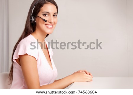 A female on a hands free phone - friendly call center - stock photo