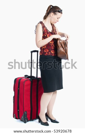 A female passenger searching for something in her bag - stock photo