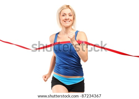 A female runner running towards a finish line isolated on white - stock photo
