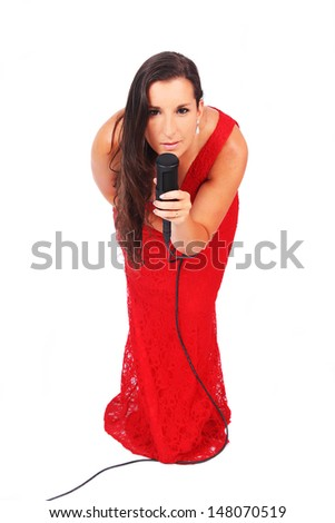 A female singer in action dressed in red in white background - stock photo