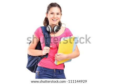 A female student with headphones isolated on white background - stock photo