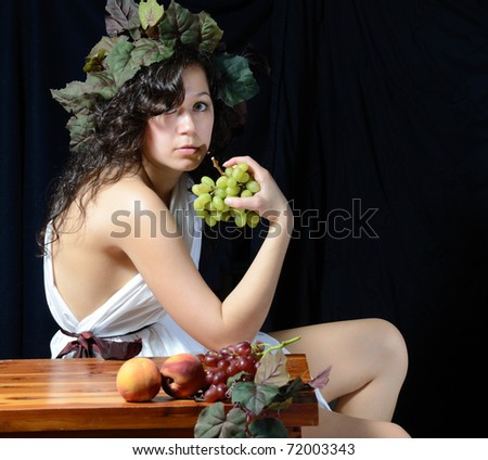 A female version of Bacchus, the roman god of the grape harvest. - stock photo