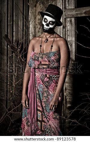 a female voodoo priestess with face paint - stock photo
