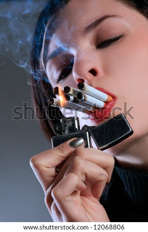 a female with six cigarettes in mouth - stock photo
