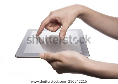 A female(woman, girl) hand support tablet pc device and finger touch(expanding) the screen isolated white at the studio.