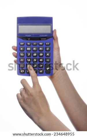 A female(woman) hand hold a calculator and pushing button isolated white at the studio.