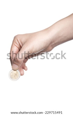 A female(woman) hand hold a coin(two euro) isolated white at the studio.