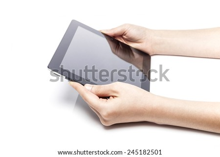 A female(woman) hand hold a empty(blank) tablet pc(pad) isolated white at the studio.