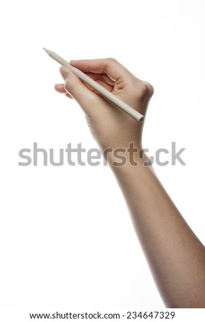 A female(woman) hand hold a pencil and writing isolated white at the studio.