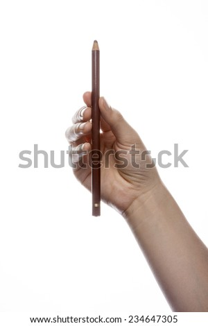 A female(woman) hand hold a pencil isolated white at the studio.