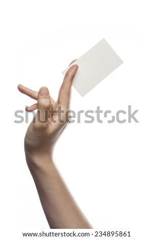 A female(woman) hand hold(pick up) a empty(blank) paper(business name card) isolated white at the studio. - stock photo