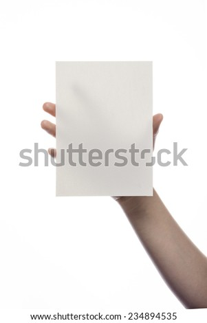 A female(woman) hand hold(pick up) a empty(blank) paper(post card) isolated white at the studio. - stock photo