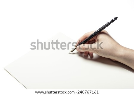 A female(woman) hand hold(write) a fountain pen and letter and ink isolated white at the studio. - stock photo