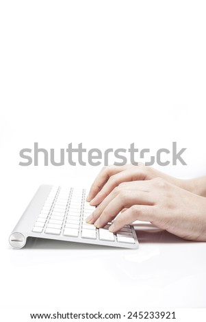 A female(woman) hand touch(push) a white keyboard isolated white at the studio. - stock photo