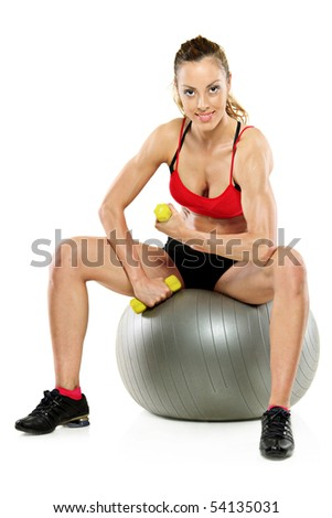 A female working out with a dumb bell isolated on white background - stock photo