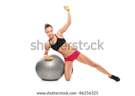 A female working out with a dumb bells isolated on white background - stock photo