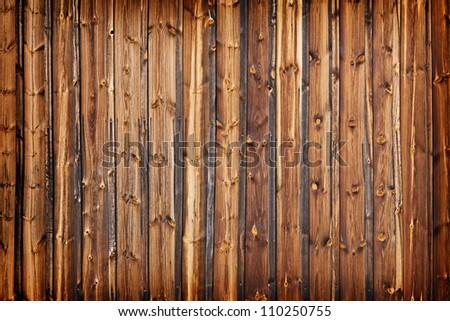 A fence made of old larch boards - grunge background - stock photo