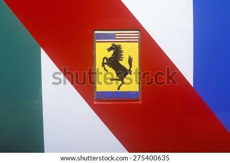 A Ferrari sports car logo in Beverly Hills, California - stock photo