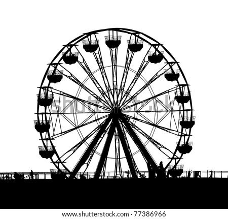 A ferris wheel at a local fun fair seen in silhouette