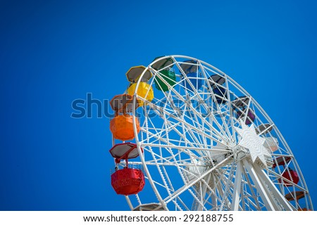 A ferris wheel on top of a hill in Barcelona. - stock photo