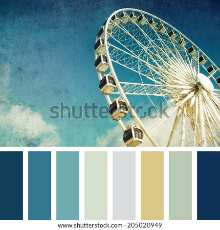 A ferris wheel, vintage style,  in a colour palette with complimentary colour swatches - stock photo