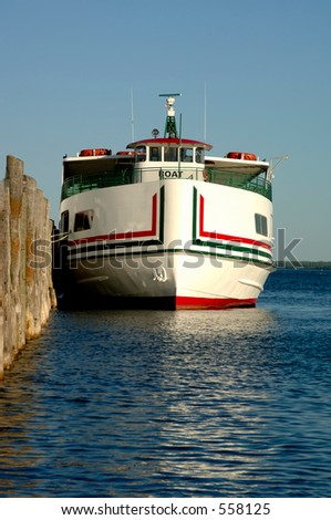A ferry boat docked at Mackinac Island, Michigan. Focus = the ferry. 12MP camera. - stock photo