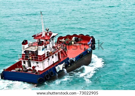 A ferry boat is carrying people to the places of interest on the sea - stock photo