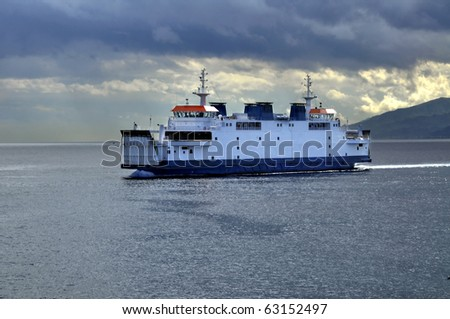 a ferry crosses the Strait of Messina