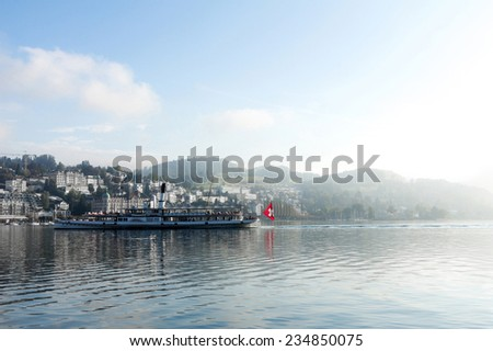 A Ferry in Lake Lucerne in a Foggy Morning - stock photo