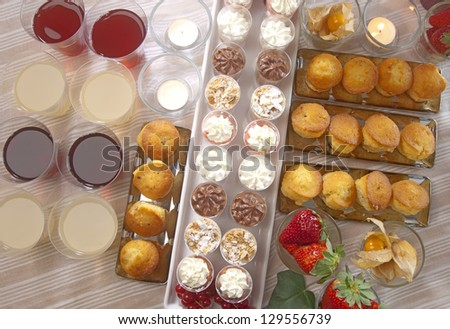 a festive buffet for a party with fruit,pastries and drinks - stock photo