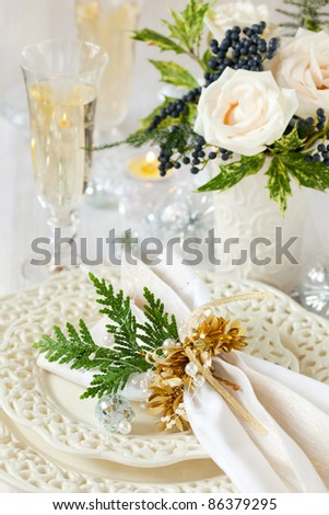 A festive table laid for Christmas - stock photo