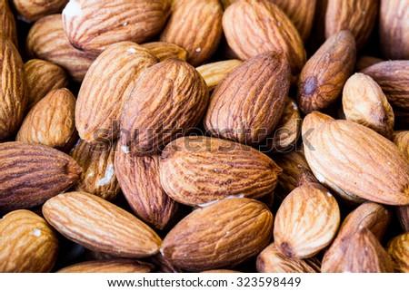 a few almonds macro - stock photo