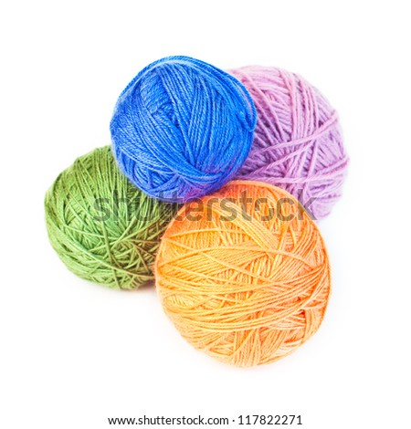 A few balls of wool on a white background