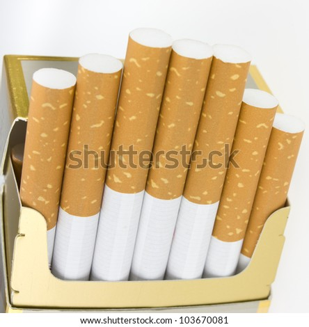 A few cigarettes on a white background