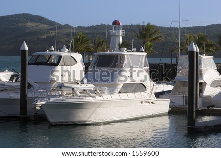 A few docked boats in the Hamilton Island Marina in the Whitsundays in Queensland. - stock photo
